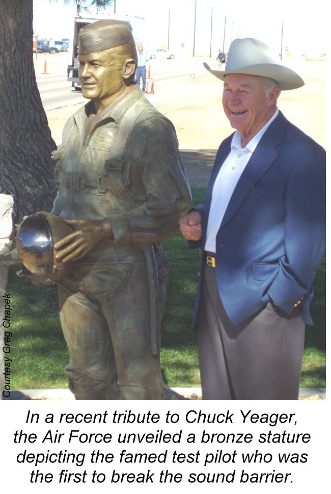 Chuck Yeager with statue